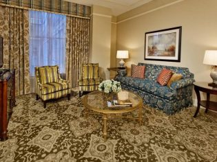 Guest suite at The Ritz-Carlton after renovations done by interior architects at Pascal Architects in New Orleans, LA